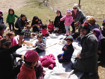 Participants in a family support program gather outside for Circle Time