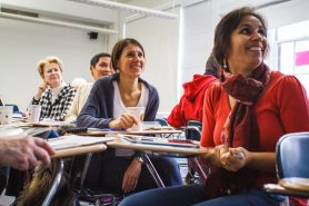 Professionals learning in a classroom
