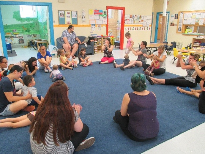Families sing together during Connections' drop-in program.